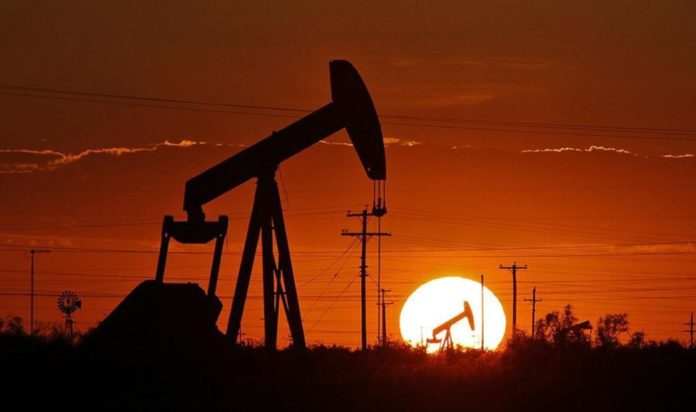 Oil holds up thanks to better demand outlook and falling US inventories