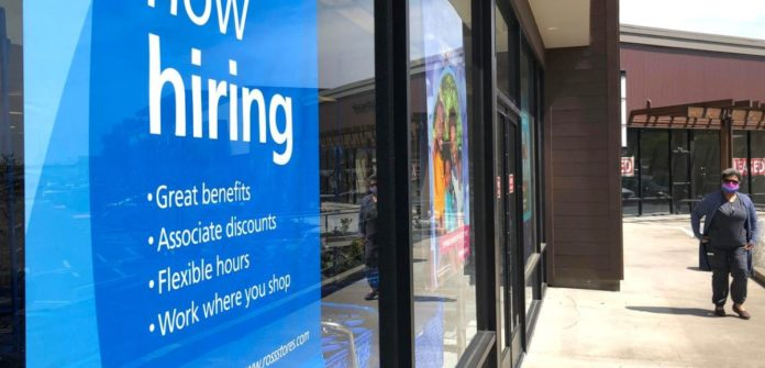 Unemployment claims hit a new low for the third consecutive week as the labor market improved